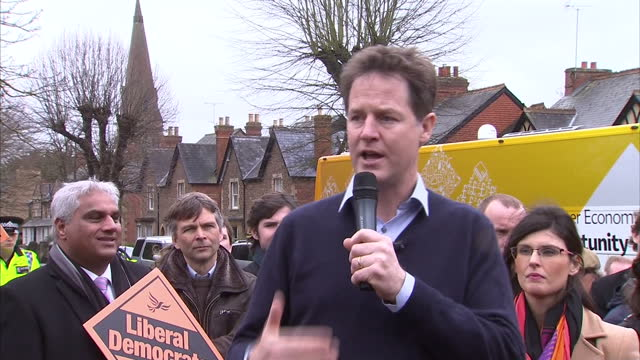 exterior shots nick clegg liberal democrat leader speaking about labours borrowing plans and says 'have they learnt nothing' during speech launching... - ニック クレッグ点の映像素材/bロール