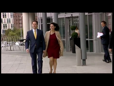 exterior shots nick clegg walks hand in hand with his wife miriam gonzalez durantes outside the liberal democrats party conference building nick... - british liberal democratic party stock videos & royalty-free footage