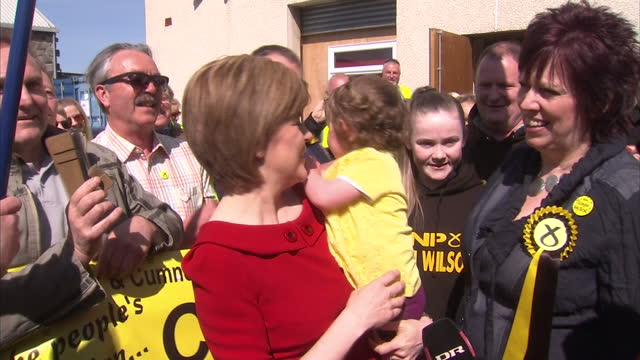 exterior shots nicola sturgeon, leader of snp pose for photos with snp supporters and candidate corrie wilson during campaigning day in ayr on april... - ayr stock videos & royalty-free footage