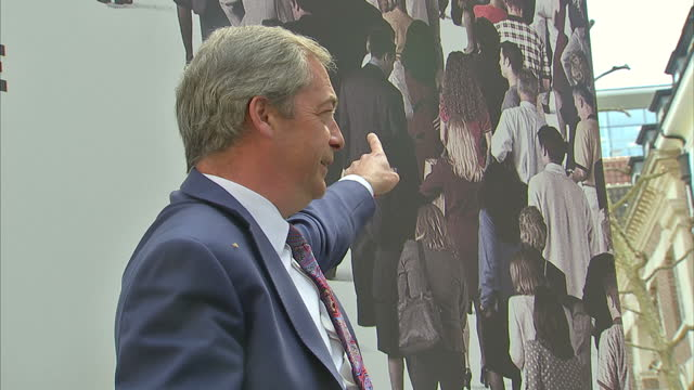exterior shots nigel farage ukip leader launches new campaign poster 'open door immigration isn't working' ahead of may 5th elections on may 03 2016... - poster stock videos and b-roll footage