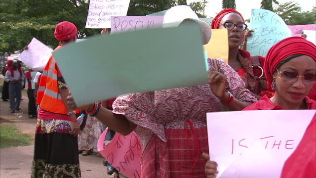 exterior shots nigeria abducted school girls - bring back our girls campaginers - 2014 stock-videos und b-roll-filmmaterial