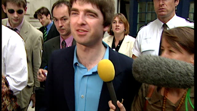 exterior shots noel gallagher and meg matthews depart 10 downing street and talk to press about the party - downing street stock videos and b-roll footage