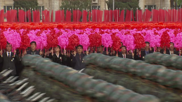 exterior shots north korean citizens waving pompoms as north korean soldiers march past at workers party 70th anniversary military parade on october... - parade stock videos & royalty-free footage