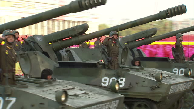 exterior shots north korean soldiers standing on military artillery tanks saluting to kim jongun north korean leader at workers party 70th... - military parade stock videos & royalty-free footage