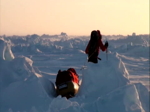 exterior shots north pole expedition trekkers hauling sleds across ice pack. exterior shots team erecting tents at sunset. prince harry is back in... - north pole stock videos & royalty-free footage