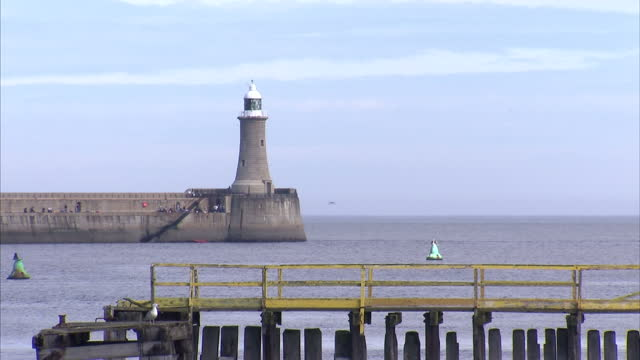 exterior shots north shields sea front mouth of the river tyne north shields fish market north pier tynemouth lighthouse north shields coastline on... - river tyne stock videos & royalty-free footage