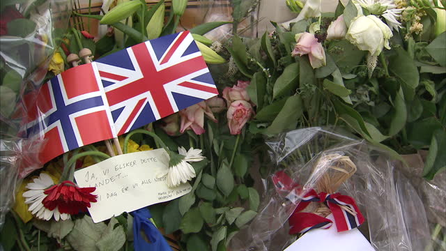 stockvideo's en b-roll-footage met exterior shots norwegian embassy in london with floral tributes on the ground outside the entrance exterior close up shots messages of sympathy... - anders behring breivik