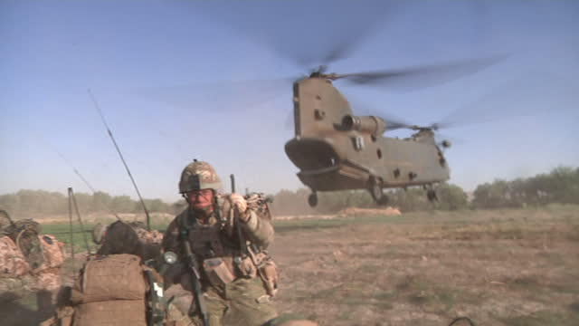 Exterior shots of 1 Scots Battalion boarding an RAF Chinook patrolling the Helmand Province in Afghanistan 1 Scots Troops Boarding RAF Chinook in...