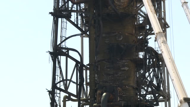exterior shots of a badly damaged saudi oil refinery with damaged stabilizer and workers in hard hats after it was hit by missiles in an attack on... - stabilisers stock videos & royalty-free footage