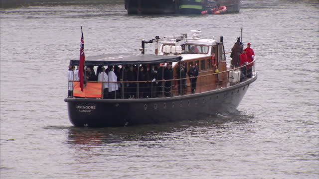Exterior shots of a barge on the River Thames as Army personnel drop off a wreath to mark 50 years since the funeral of Winston Churchill on January...