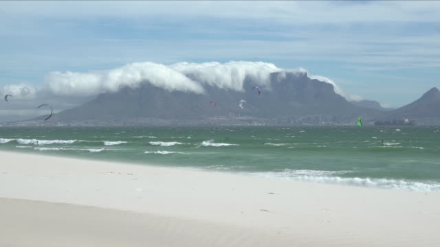 Exterior shots of a beach in Cape Town with kite surfers in action and Table Mountain in the background on 5 March 2018 in Cape Town South Africa