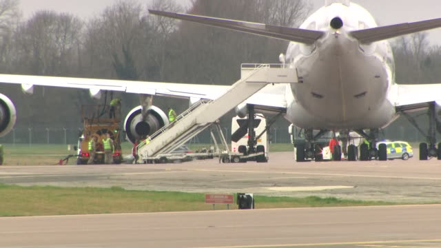 exterior shots of a boeing 747 plane parked on tarmac at brize norton as passengers evacuated from wuhan disembark on 31 january 2020 in brize norton... - commercial aircraft stock videos & royalty-free footage