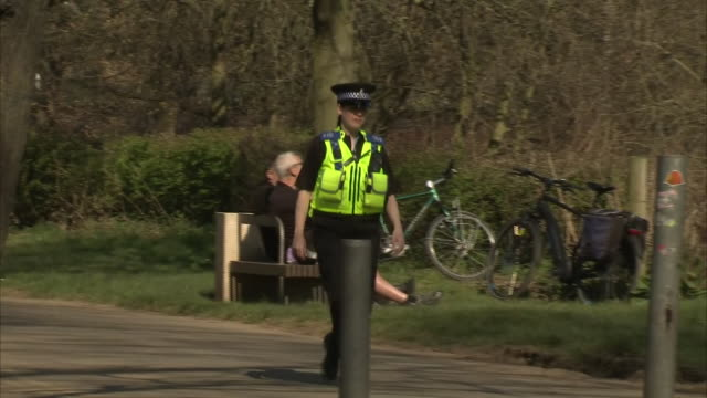 exterior shots of a british police officer patrolling a park during the coronavirus epidemic and lockdown on 25th march 2020 york, united kingdom. - public park stock videos & royalty-free footage