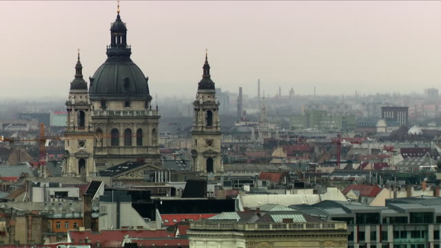 exterior shots of a budapest city skyline including st stephen's basilica over the danube on 7 april 2018 in budapest hungary - ungarn stock-videos und b-roll-filmmaterial