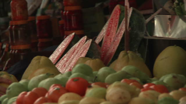exterior shots of a busy ashkelon marketplace with shoppers walking around inspecting produce on march 17 2015 in ashkelon israel - ashkelon stock videos and b-roll footage