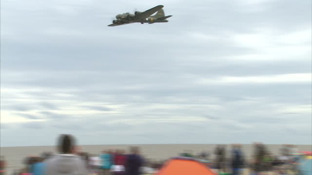exterior shots of a canadian air force lancaster bomber taking part in an aerial display for crowds at the clacton airshow on august 27 2015 in... - lancaster bomber stock videos & royalty-free footage