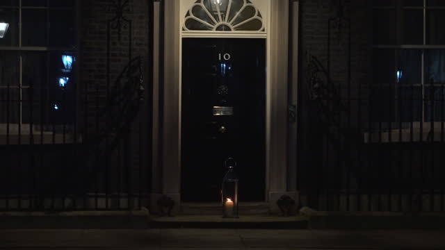 exterior shots of a candle being placed outside the door of 10 downing street in the wake of the murder of sarah everard on 13 march 2021 in london,... - candle stock videos & royalty-free footage