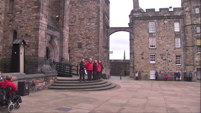 exterior shots of a canon being fired from battlements of edinburgh castle to signal the start of a two minute silence on armistice day and people... - edinburgh castle stock videos & royalty-free footage