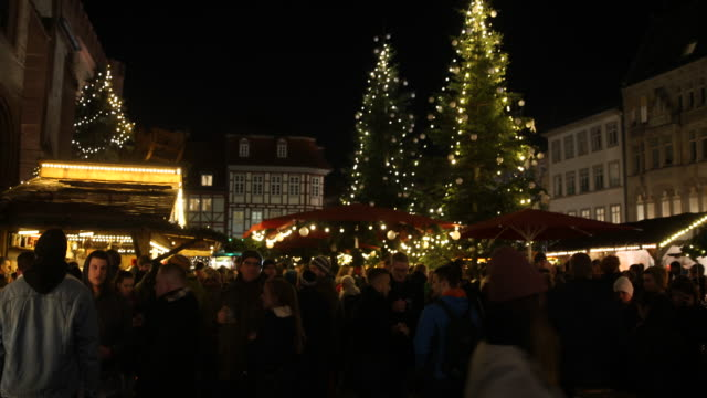 exterior shots of a christmas market with christmas decoration and christmas tree in germany visitors are enjoying arts and crafts and are tasting... - advent calendar stock videos & royalty-free footage