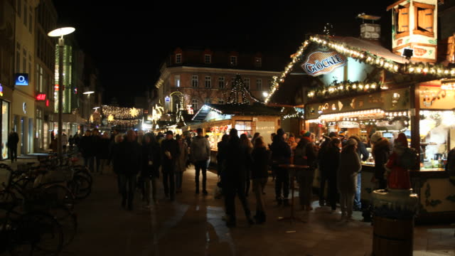 exterior shots of a christmas market with christmas decoration in germany visitors are enjoying arts and crafts and are tasting drinks like mulled... - advent calendar stock videos & royalty-free footage