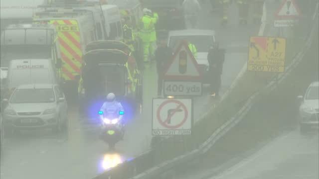exterior shots of a coroners van driving away from the plane crash site in shoreham on august 25 2015 in shoreham england - ショーハム・バイ・シー点の映像素材/bロール
