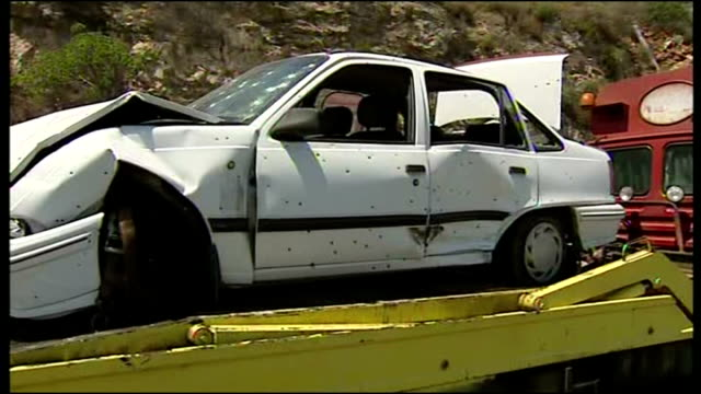 Exterior shots of a crashed car peppered with shrapnel holes after being hit in the aftermath of a rocket explosion in Haifa during the 2006 war...