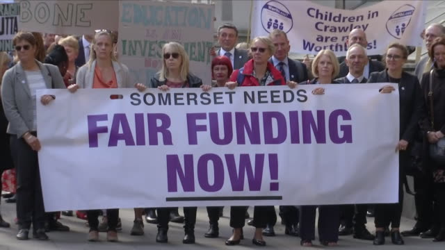 exterior shots of a crowd of head teachers with banners representing their regions delivering a petition to downing street on 28 september 2018 in... - head teacher stock videos & royalty-free footage