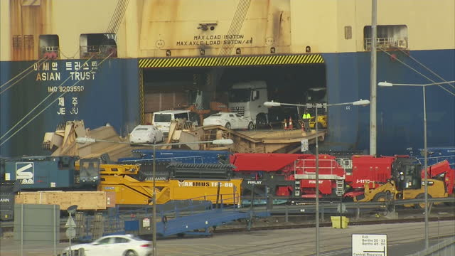 exterior shots of a cruise liner and other ships in southampton dock and jcb's and luxury cars on the dockside awaiting export on october 27 2016 in... - southampton england stock videos and b-roll footage