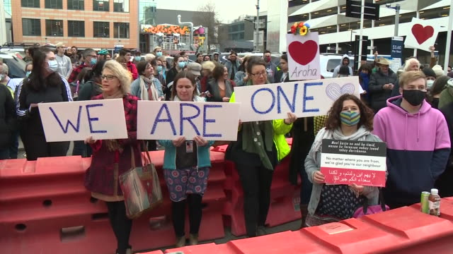 exterior shots of a demonstration outside christchurch high court with during the sentencing of mosque killer brenton tarrant with people holding up... - sentencing stock videos & royalty-free footage