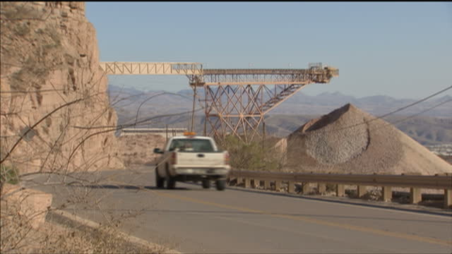 Exterior shots of a disused Arizona copper mine including a parked dump truck conveyor belt and piles of copper dust on February 12 2009 in Phoenix...