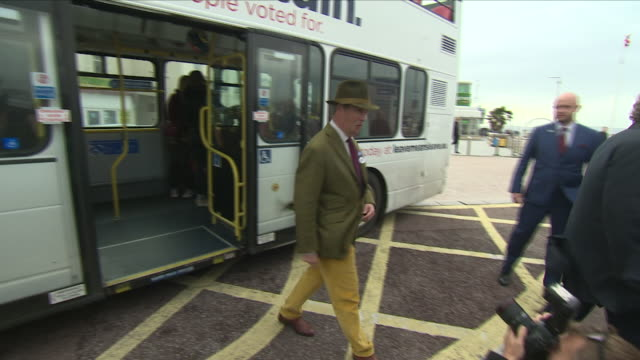 Exterior shots of a double decker campaign bus with 'Believe in Britain' and 'Leave means Leave' signwriting arriving in Torquay and former UKIP...