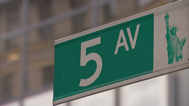 exterior shots of a fifth avenue street sign outside trump tower on march 11, 2016 in new york, ny. - fifth avenue stock videos & royalty-free footage
