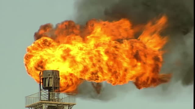 exterior shots of a flaming chimney at an oil or gas refinery in xinjiang province and pipeline construction work underway on may 22 2014 in xinjiang... - {{relatedsearchurl('capsule pipeline')}} stock videos and b-roll footage