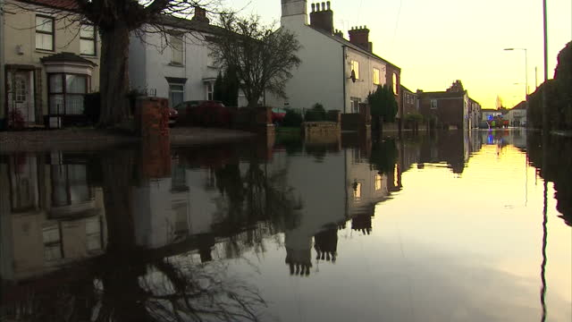 exterior shots of a flooded residential street in boston lincolnshire many homes and businesses affected by flooding on december 06 2013 in boston... - lincolnshire stock videos & royalty-free footage