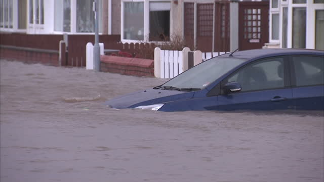 exterior shots of a flooded residential street in rhyl wales with a fire and rescue vehicle manoeuvring at the end of the road high winds and... - 2013 stock videos & royalty-free footage