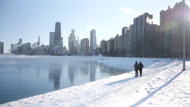 exterior shots of a frozen lake michigan and chicago skyline - great lakes stock videos & royalty-free footage