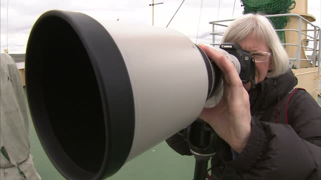 exterior shots of a generic photographer taking a picture with a telephoto lens some anonymous shots on august 25 2007 in cambridge bay canada - telephoto lens stock videos and b-roll footage
