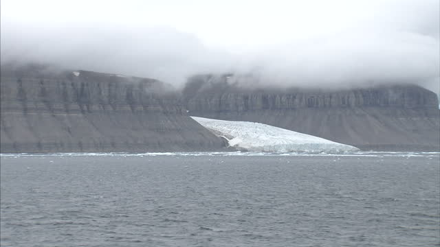 exterior shots of a glacier debouching into the sea in the arctic and north west passage on august 25 2007 in cambridge bay canada - sea passage stock videos and b-roll footage