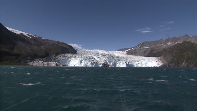 exterior shots of a glacier on the kenai peninsula from aboard a boat in the gulf of alaska on a clear sunny day on 15th september 2015 in alaska,... - kenai peninsula stock videos & royalty-free footage