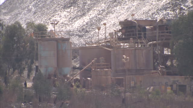 stockvideo's en b-roll-footage met exterior shots of a gold mine outside johannesburg and a child looking out over a shanty town johannesburg gold mine and shanty town on september 23... - gauteng provincie