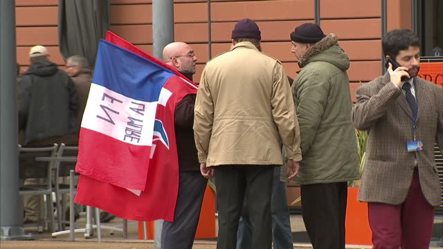 exterior shots of a group of front national supporters milling about before a rally by leader marine le pen>> on february 05 2017 in lyon france - national front stock videos and b-roll footage