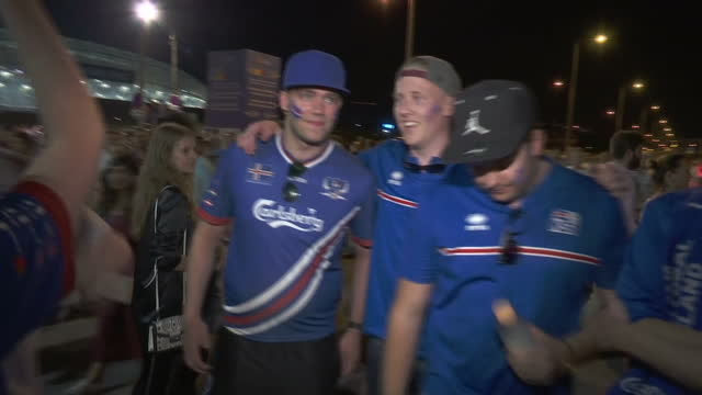 exterior shots of a group of iceland fans being congratulated by passing england fans and speaking about the most amazing result of iceland beating... - euro 2016 stock videos and b-roll footage