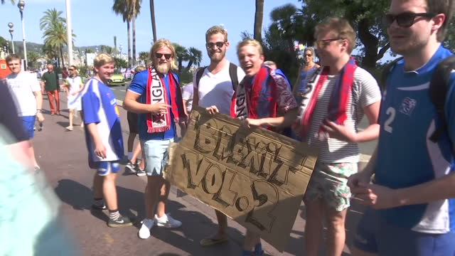 exterior shots of a group of icelandic football fans posing with a sign with the slogan brexit vol 2 and chanting as they walk along the street... - england stock videos & royalty-free footage