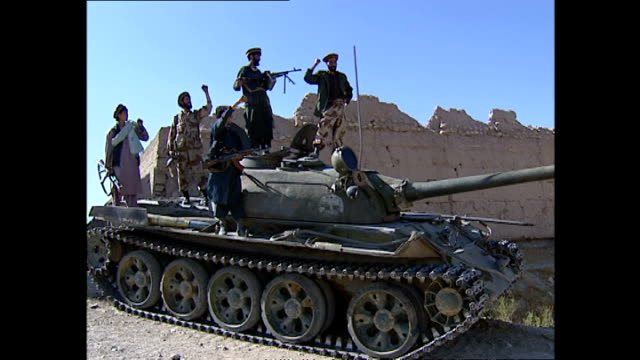 exterior shots of a group of northern alliance fighters posing on top of a tank>> on october 14 2001 in kapisa province afghanistan - 2001 stock videos & royalty-free footage