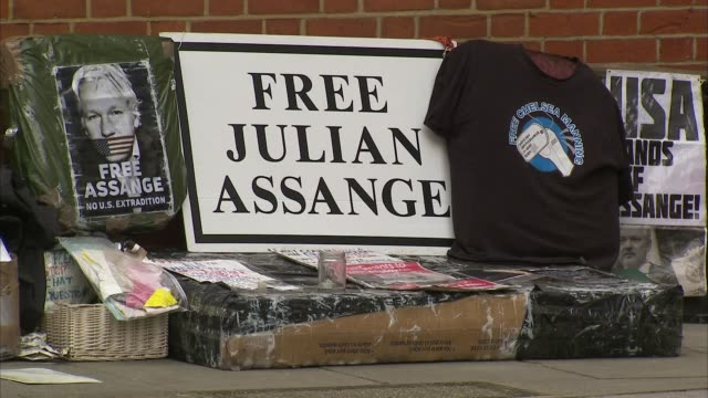 exterior shots of a group of projulian assange protesters outside the ecuadorian embassy with 'free julian assange' banners as rumours spread that he... - gossip stock videos & royalty-free footage