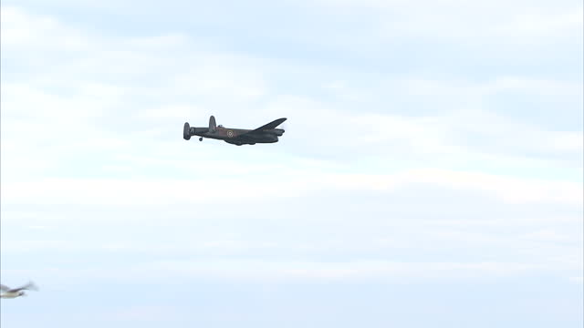 exterior shots of a hawker hurricane and avro lancaster performing in the sunderland airshow on july 28 2016 in sunderland england - lancaster bomber stock videos & royalty-free footage