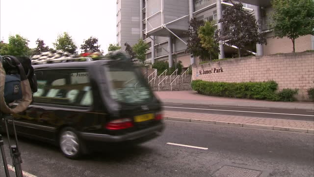 exterior shots of a hearse carrying the coffin of mh17 crash victim liam sweeney driving past st james' park football stadium>> on august 21 2014 in... - hearse stock videos & royalty-free footage