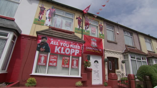 exterior shots of a house decorated in liverpool flags and posters, celebrating their premier league title win. - flag stock videos & royalty-free footage