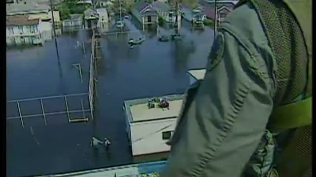 exterior shots of a huey medevac helicopter laning opn a rooftop and people wading through floods being rescued by military personnel on september 20... - hurricane katrina stock videos and b-roll footage
