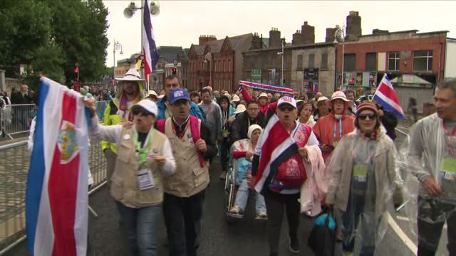 exterior shots of a huge parade of people en route to hear a mass by the pope, carrying their national flags, including a group of catholics from... - costa rica stock videos & royalty-free footage